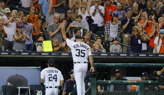 Detroit Tigers pitcher Justin Verlander waves to the crowd after the final out in the top of the eighth inning of the team's baseball game against the Pittsburgh Pirates in Detroit, Wednesday, Aug. 9, 2017. (AP Photo/Paul Sancya)