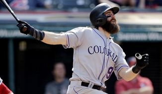 Colorado Rockies' Charlie Blackmon watches his ball after hitting a solo home run off Cleveland Indians relief pitcher Zach McAllister in the 12th inning of a baseball game, Wednesday, Aug. 9, 2017, in Cleveland. The Rockies won 3-2 in 12 innings. (AP Photo/Tony Dejak)