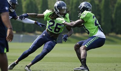 Seattle Seahawks cornerback Shaquill Griffin (26) goes up against cornerback Pierre Desir, right, during NFL football training camp, Monday, Aug. 7, 2017, in Renton, Wash. (AP Photo/Ted S. Warren)