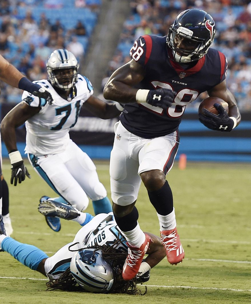 Houston Texans running back Alfred Blue (28) runs to the end zone for a touchdown against Carolina Panthers defensive back Dezmen Southward (37) during the first half of an NFL preseason football game, Wednesday, Aug. 9, 2017, in Charlotte, N.C. (AP Photo/Mike McCarn)