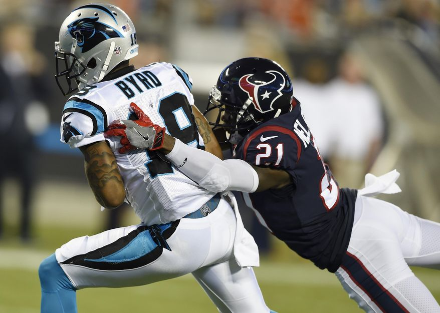 Carolina Panthers wide receiver Damiere Byrd (18) runs into the end zone for a touchdown against Houston Texans defensive back Marcus Gilchrist (21) during the first half of an NFL preseason football game, Wednesday, Aug. 9, 2017, in Charlotte, N.C. (AP Photo/Mike McCarn)