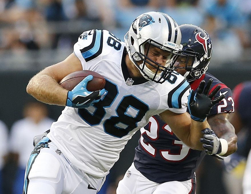 Carolina Panthers tight end Greg Olsen (88) runs against Houston Texans free safety Kurtis Drummond (23) during the first half of an NFL preseason football game, Wednesday, Aug. 9, 2017, in Charlotte, N.C. (AP Photo/Jason E. Miczek)