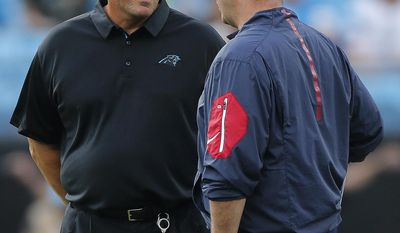 Carolina Panthers head coach Ron Rivera, left, speaks with Houston Texans head coach Bill O'Brien before the first half of an NFL preseason football game, Wednesday, Aug. 9, 2017, in Charlotte, N.C. (AP Photo/Jason E. Miczek)