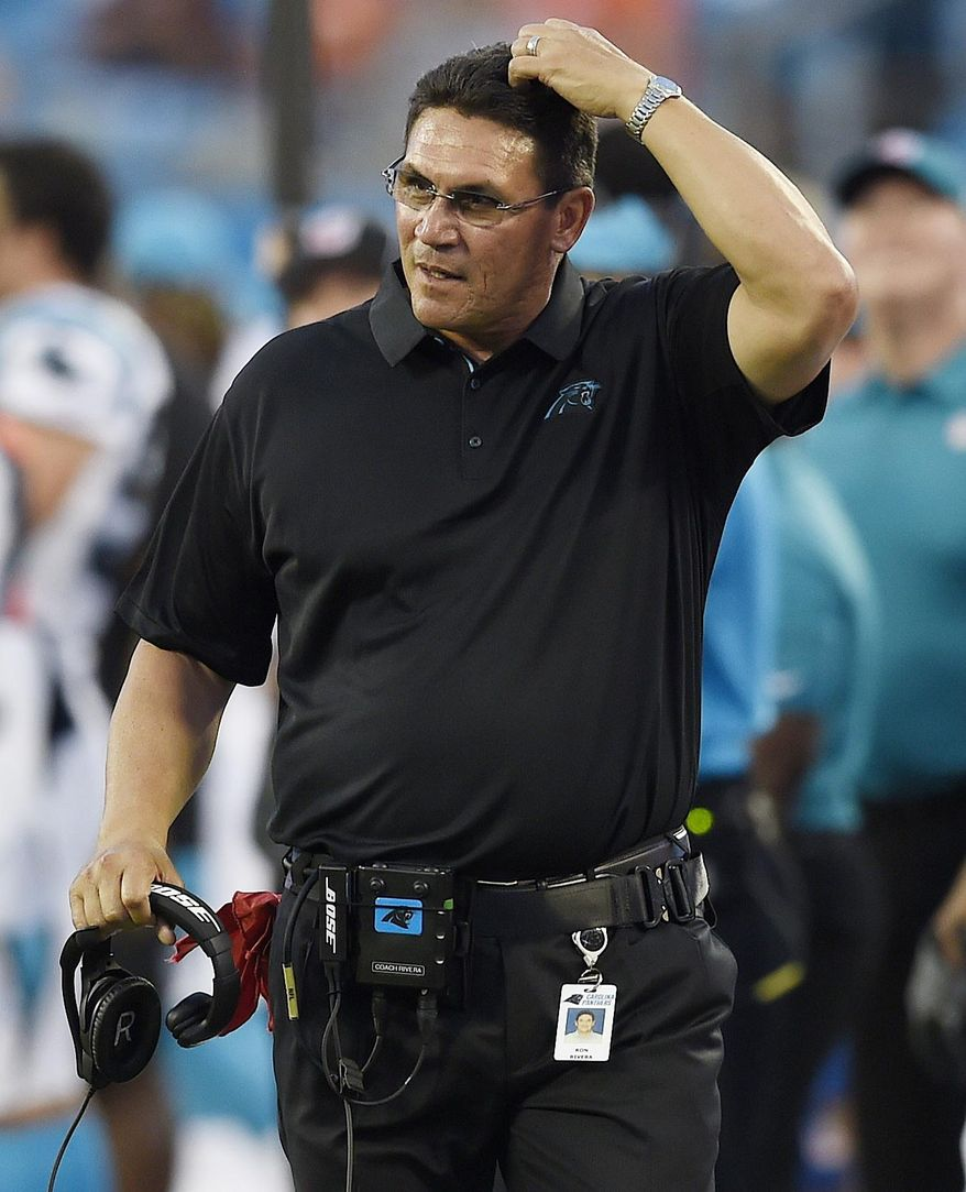 Carolina Panthers head coach Ron Rivera walks the sidelines against the Houston Texans during the first half of an NFL preseason football game, Wednesday, Aug. 9, 2017, in Charlotte, N.C. (AP Photo/Mike McCarn)