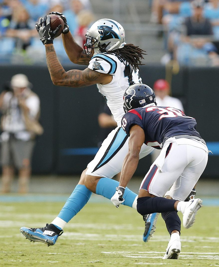 Carolina Panthers wide receiver Kelvin Benjamin (13) makes the catch against Houston Texans cornerback Kevin Johnson (30) during the first half of an NFL preseason football game, Wednesday, Aug. 9, 2017, in Charlotte, N.C. (AP Photo/Jason E. Miczek)