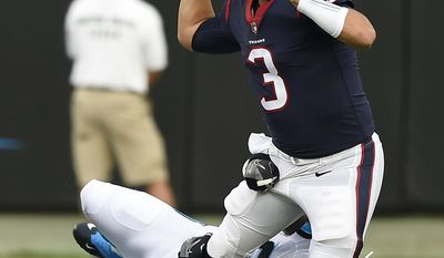 Carolina Panthers defensive tackle Kawann Short (99) tackles Houston Texans quarterback Tom Savage (3) during the first half of an NFL preseason football game, Wednesday, Aug. 9, 2017, in Charlotte, N.C. (AP Photo/Mike McCarn)