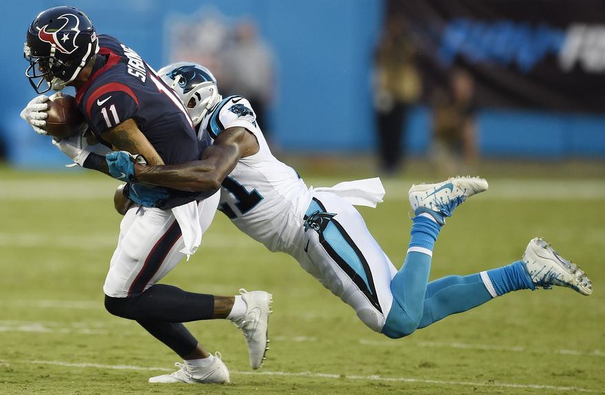 Houston Texans wide receiver Jaelen Strong (11) runs against Carolina Panthers defensive back Teddy Williams (21) during the first half of an NFL preseason football game, Wednesday, Aug. 9, 2017, in Charlotte, N.C. (AP Photo/Mike McCarn)
