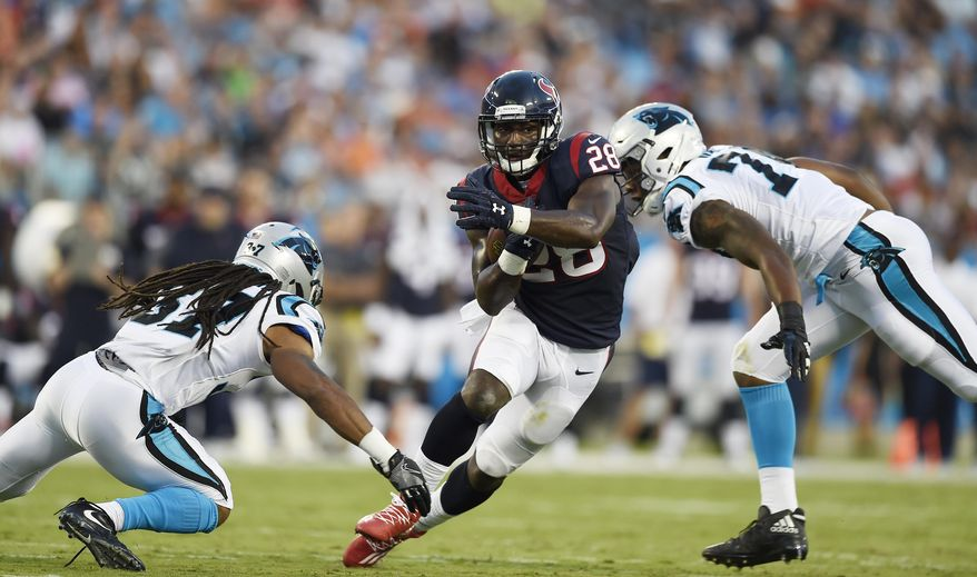 Houston Texans running back Alfred Blue (28) runs near Carolina Panthers defensive back Dezmen Southward (37) during the first half of an NFL preseason football game, Wednesday, Aug. 9, 2017, in Charlotte, N.C. (AP Photo/Mike McCarn)