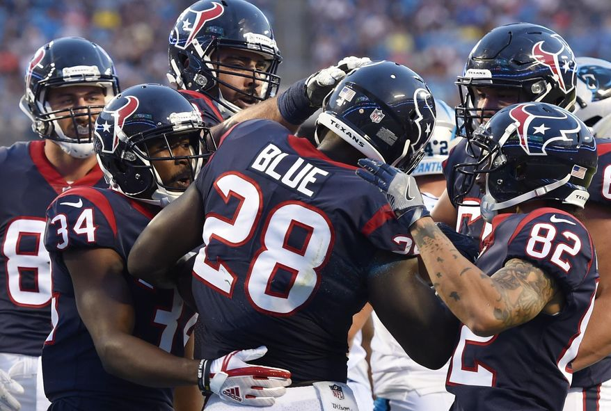 Houston Texans running back Alfred Blue (28) celebrates his touchdown with team mates against the Carolina Panthers during the first half of an NFL preseason football game, Wednesday, Aug. 9, 2017, in Charlotte, N.C. (AP Photo/Mike McCarn)