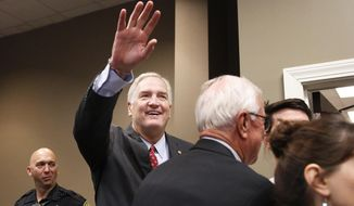 "Alabama Sen. Luther Strange waves to constituents before a Republican Senate candidate forum, Friday, Aug. 4, 2017, in Pelham, Ala. President Donald Trump on Tuesday endorsed Strange as he goes into a contentious GOP primary election next week. ""Senator Luther Strange has done a great job representing the people of the Great State of Alabama. He has my complete and total endorsement!"" Trump wrote. (AP Photo/Brynn Anderson)"