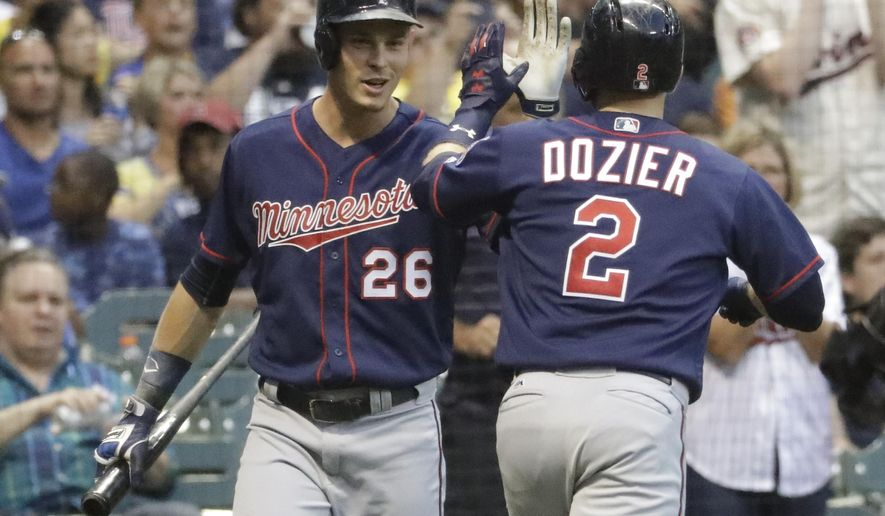 Minnesota Twins' Brian Dozier is congratulated by Max Kepler (26) after hitting a home run during the third inning of a baseball game against the Milwaukee Brewers Wednesday, Aug. 9, 2017, in Milwaukee. (AP Photo/Morry Gash)