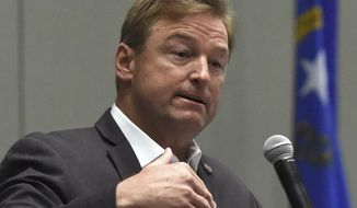 In this April 17, 2017, file photo, Nevada Sen. Dean Heller, R-Nev., answers a question during a town hall at the Reno Sparks Convention Center in Reno, Nev. (Andy Barron /The Reno Gazette-Journal via AP, File)