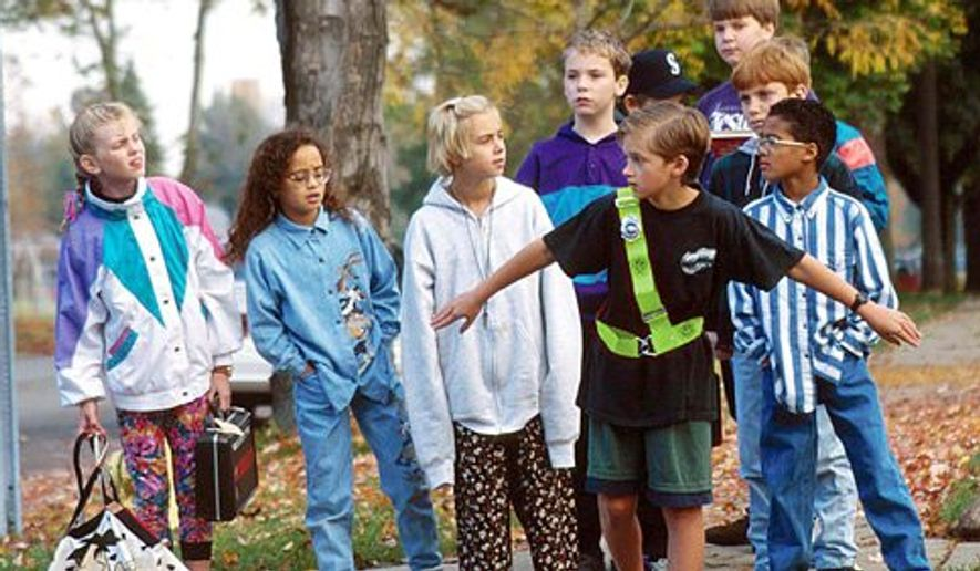 Getting students safely to and from school is a top priority. The AAA School Safety Patrol Program helps ensure that kids can do that. Ushers lead kids across intersections. (AAA)