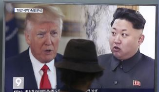 A man watches a television screen showing U.S. President Donald Trump, left, and North Korean leader Kim Jong-un during a news program at the Seoul Train Station in Seoul, South Korea, Thursday, Aug. 10, 2017. North Korea has announced a detailed plan to launch a salvo of ballistic missiles toward the U.S. Pacific territory of Guam, a major military hub and home to U.S. bombers. If carried out, it would be the North's most provocative missile launch to date. (AP Photo/Ahn Young-joon)