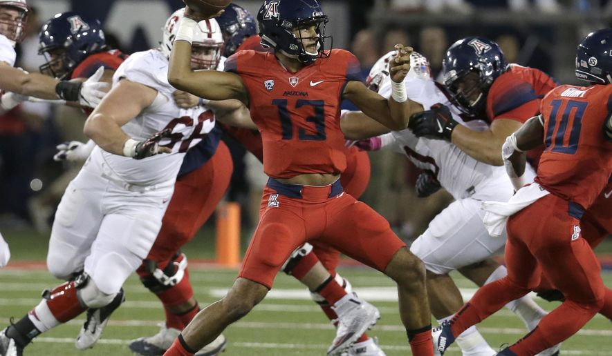 FILE - In this Oct. 29, 2016, file photo, Arizona quarterback Brandon Dawkins (13) throws during the first half of an NCAA college football game against Stanford in Tucson, Ariz. (AP Photo/Rick Scuteri, File)