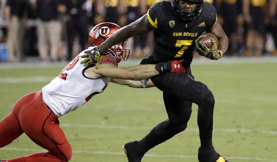 FILE - In this Nov. 10, 2016, file photo, Arizona State running back Kalen Ballage (7) sheds Utah defensive back Chase Hansen (22) during the first half of an NCAA college football game in Tempe, Ariz. Seniors Ballage and Demario Richard were not nearly as productive last season as they were in 2015, but that was in part because Arizona State found itself constantly having to play catch-up because of its defense. (AP Photo/Matt York, File)