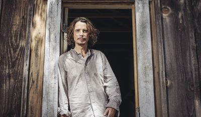 """FILE - In this July 29, 2015 file photo, Chris Cornell poses for a portrait to promote his latest album, """"Higher Truth,"""" during a music video shoot in Agoura Hills, Calif. Cornell's widow told The Seattle Times for a story published Aug. 9, 2017, that she has commissioned a statue of the late Soundgarden frontman to be placed in his home town of Seattle. (Photo by Casey Curry/Invision/AP, File)"""