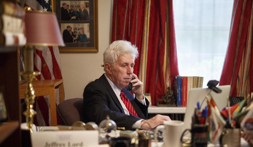FILE- In this Sept. 16, 2016, file photo, Jeffrey Lord prepares for a CNN broadcast from his home office in Camp Hill, Pa. CNN cut ties Thursday, Aug. 10, 2017, with Lord, a conservative commentator, after he tweeted a Nazi salute at a critic. (Daniel Zampogna/PennLive.com via AP, File)