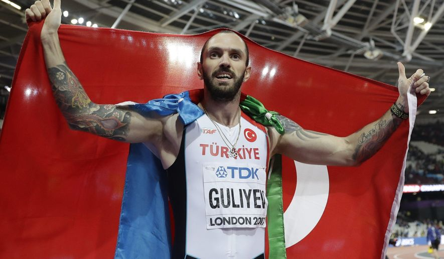 CORRECTS DISTANCE - Turkey's Ramil Guliyev celebrates after winning the gold medal in the men's 200-meter final during the World Athletics Championships in London Thursday, Aug. 10, 2017. (AP Photo/Matthias Schrader)