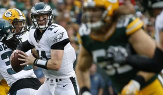 Philadelphia Eagles' Carson Wentz throws during the first half of a preseason NFL football game against the Green Bay Packers Thursday, Aug. 10, 2017, in Green Bay, Wis. (AP Photo/Mike Roemer)