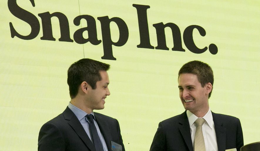 FILE - In this Thursday, March 2, 2017, file photo, Snap co-founders Bobby Murphy, left, and CEO Evan Spiegel ring the opening bell at the New York Stock Exchange as the company celebrates its IPO. Snap Inc. reports earnings, Thursday, Aug. 10, 2017. (AP Photo/Richard Drew, File)