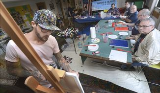 In this July 9, 2017 photo, Jeremy Johnson, bring his art and teaching skills to the Illinois  Valley Brain Injury Clubhouse in Streator, Ill. John is a brain tumor survivor and teaches abstract art as a way to get in touch with people's innate creativity. (Tom Sistak/Ottawa Times via AP)