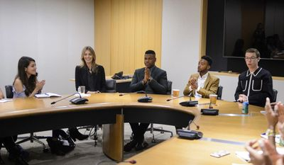 """This Aug. 5, 2017 photo released by the Academy of Motion Picture Arts and Sciences shows director Kathryn Bigelow, second left, with actors from her latest film, """"Detroit,"""" from right, Will Poulter, Algee Smith and John Boyega and Academy Gold intern Jocelyn Contreras, left, as they take part in the Academy Gold internship program for undergraduate and graduate students at the Academy of Motion Picture Arts and Sciences in Beverly Hills, Calif. (A.M.P.A.S. via AP)"""
