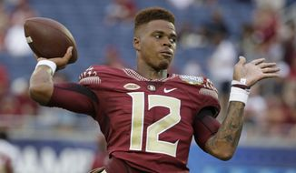 In this Sept. 5, 2016 file photo, Florida State quarterback Deondre Francois (12) warms up before an NCAA college football game against Mississippi in Orlando, Fla. Florida State, which returns 17 starters from a team that finished 10-3 last year, will find out immediately if it will contend for a College Football Playoff spot. The Seminoles open against Alabama in Atlanta on Sept. 2. (AP Photo/John Raoux. File)