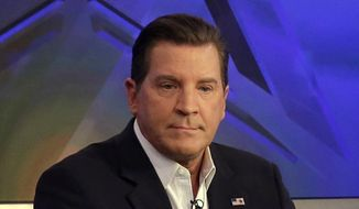 "In this July 22, 2015, file photo, co-host Eric Bolling appears on ""The Five"" television program, on the Fox News Channel, in New York. Bolling is suing the reporter who broke the story that he allegedly sent lewd text messages to colleagues. Bolling filed a $50 million defamation lawsuit Wednesday against Yashar Ali, a Huffington Post contributing writer. (AP Photo/Richard Drew, File)"