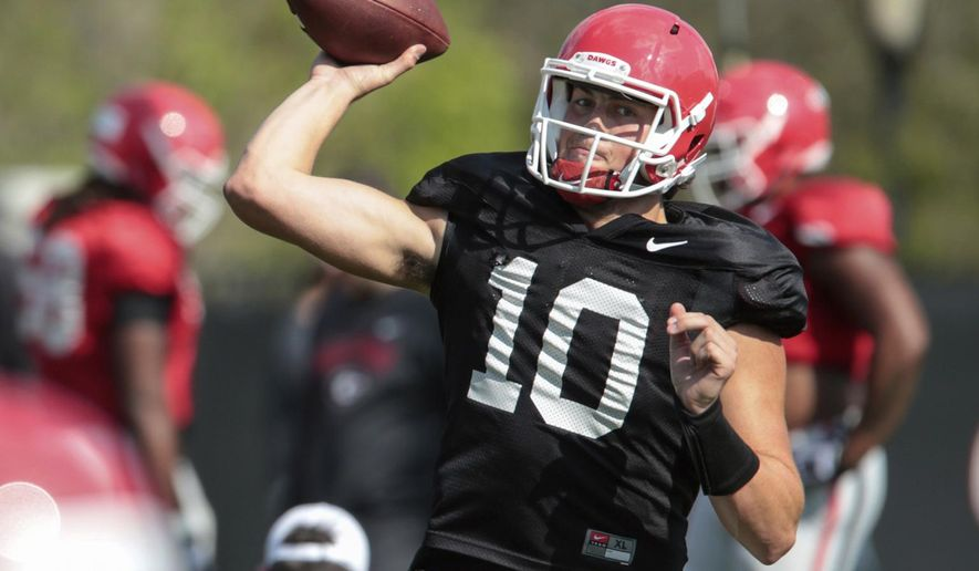 FILE - In this March 28, 2017, file photo, Georgia quarterback Jacob Eason (10) throws during spring NCAA college practice in Athens, Ga. (John Roark/Athens Banner-Herald via AP, File)