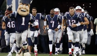 New England Patriots quarterback Tom Brady (12) leads his team onto the field for an NFL preseason football game against the Jacksonville Jaguars, Thursday, Aug. 10, 2017, in Foxborough, Mass. (AP Photo/Mary Schwalm)