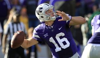 FILE - In this Nov. 5, 2016, file photo, Kansas State quarterback Jesse Ertz (16) throws during the second half of an NCAA college football game against Oklahoma State, in Manhattan, Kan. Bill Snyder is back on the sideline and Jesse Ertz is back under center, and those two facts alone are enough to make Kansas State a dangerous contender in a wide-open Big 12 this season. (AP Photo/Orlin Wagner, File)