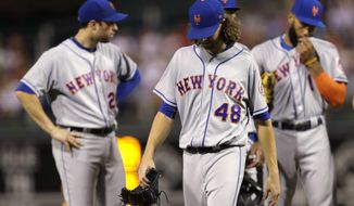 New York Mets starting pitcher Jacob deGrom walks off the field after being injured during the seventh inning of a baseball game against the Philadelphia Phillies, Thursday, Aug. 10, 2017, in Philadelphia. New York won 10-0. (AP Photo/Matt Slocum)
