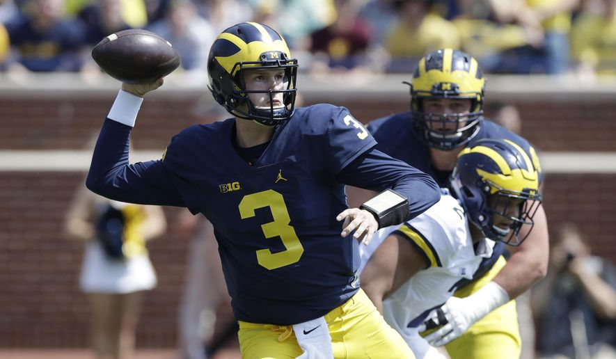 FILE - In an April 15, 2017, file photo, Michigan quarterback Wilton Speight throws during the Michigan spring football game in Ann Arbor, Mich. Speight seems like the QB to beat, coming off an 11-start season in which he completed 62 percent of his passes and threw 18 touchdowns and just seven interceptions. (AP Photo/Carlos Osorio_File)