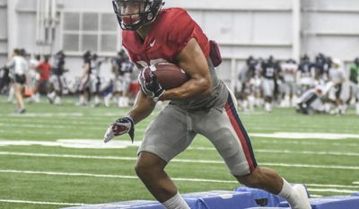Mississippi running back Jordan Wilkins runs through a drill during NCAA college football practice at the Manning Center, in Oxford, Miss. on Monday, Aug. 7, 2017. (Bruce Newman, TheOxford Eagle via AP)