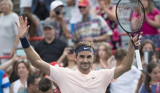 Roger Federer, of Switzerland, celebrates his 4-6, 6-4, 6-2 victory over David Ferrer, of Spain, at the Rogers Cup tennis tournament Thursday, Aug. 10, 2017, in Montreal. (Paul Chiasson/The Canadian Press via AP)