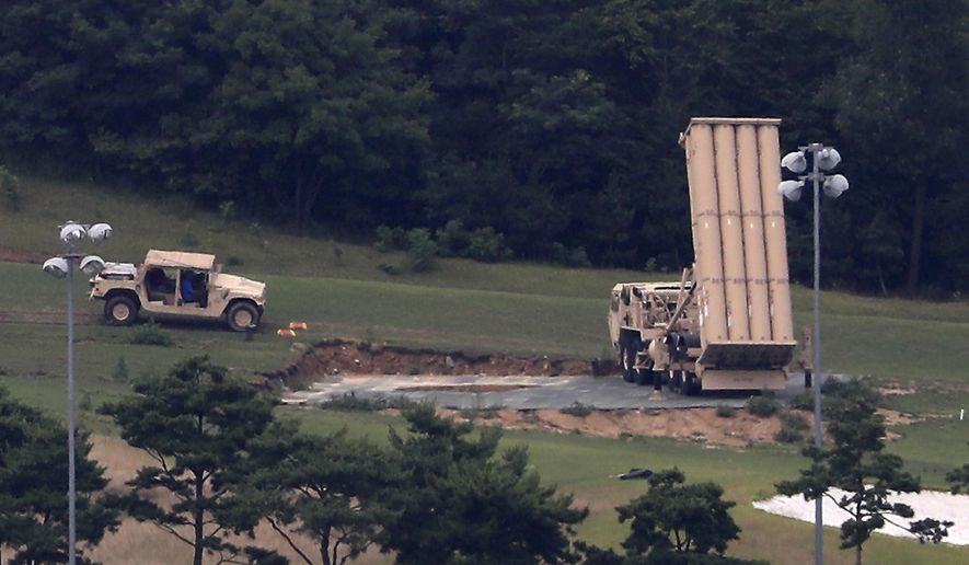 FILE - In this July 4, 2017, file photo, a U.S. missile defense system called Terminal High Altitude Area Defense, or THAAD, is seen at a golf course in Seongju, South Korea. North Korea claims it is in the final stages of preparing a plan to launch four intermediate-range ballistic missiles over Japan and into waters just off the island of Guam, where about 7,000 U.S. troops are based. The U.S. has pumped billions of dollars into its missile defense systems and sold hundreds of millions of dollars' worth to its allies, including the very controversial deployment of a state-of-the-art system known by its acronym, THAAD, in South Korea. (Kim Jun-beom/Yonhap via AP, File)