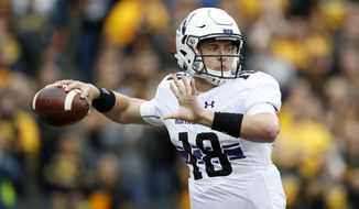 FILE- In this Oct. 1, 2016, file photo, Northwestern quarterback Clayton Thorson throws a pass during the first half of an NCAA college football game against Iowa, in Iowa City, Iowa. Coming off a 10-win season in 2015, Northwestern dropped three of its first four games on the way to a 7-6 record. (AP Photo/Charlie Neibergall, File)