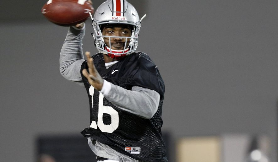 FILE - In this March 7, 2017, file photo, Ohio State quarterback J.T. Barrett runs a drill during an NCAA college football practice in Columbus, Ohio. Barrett is an oddity in modern college football, an elite player who stuck around for five years, a guy who helped win a national championship but still has something to prove. (AP Photo/Jay LaPrete, File)