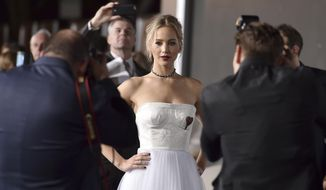 "In this Dec. 14, 2016, file photo, Jennifer Lawrence arrives at the Los Angeles premiere of ""Passengers"" at the Village Theatre Westwood. Lawrence opened up on her relationship with director Darren Aronofsky in an interview with Vogue magazine published online on Aug. 9, 2017. (Photo by Jordan Strauss/Invision/AP, File)"