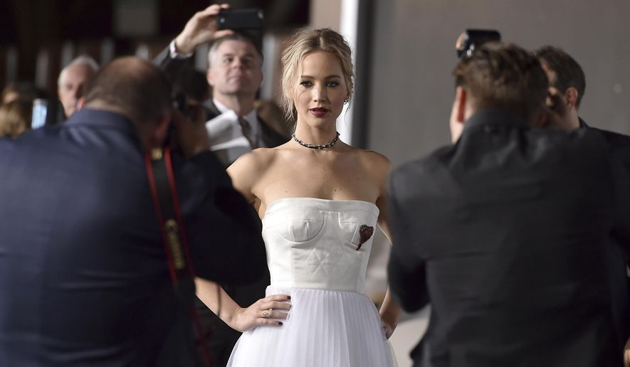 """In this Dec. 14, 2016, file photo, Jennifer Lawrence arrives at the Los Angeles premiere of """"Passengers"""" at the Village Theatre Westwood. Lawrence opened up on her relationship with director Darren Aronofsky in an interview with Vogue magazine published online on Aug. 9, 2017. (Photo by Jordan Strauss/Invision/AP, File)"""