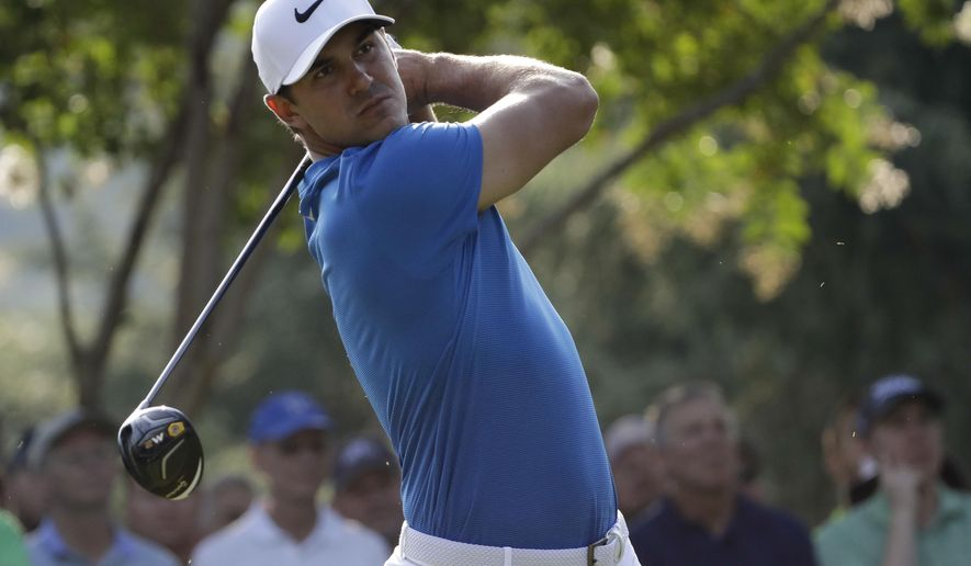 Brooks Koepka watches his tee shot on the 11th hole during the first round of the PGA Championship golf tournament at the Quail Hollow Club Thursday, Aug. 10, 2017, in Charlotte, N.C. (AP Photo/Chris O'Meara)