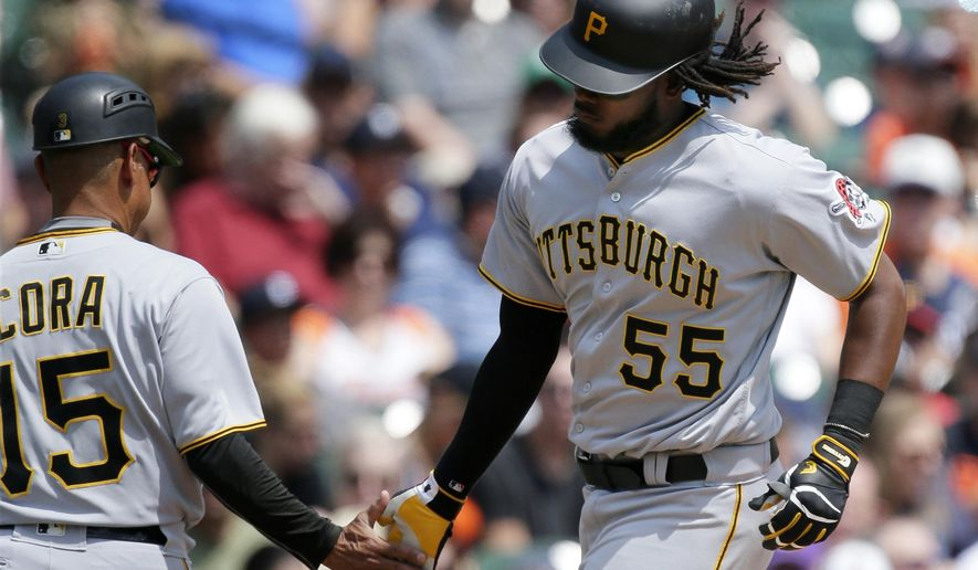 Pittsburgh Pirates' Josh Bell (55) is congratulated by third base coach Joey Cora (15) after hitting a two-run home run against the Detroit Tigers during the third inning of an interleague baseball game Thursday, Aug. 10, 2017, in Detroit. (AP Photo/Duane Burleson)