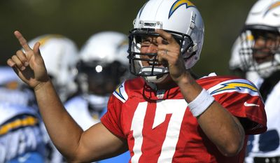 Los Angeles Chargers quarterback Philip Rivers gestures to his team during a joint NFL football practice with the Los Angeles Rams, Wednesday, Aug. 9, 2017, in Irvine, Calif. (AP Photo/Mark J. Terrill)