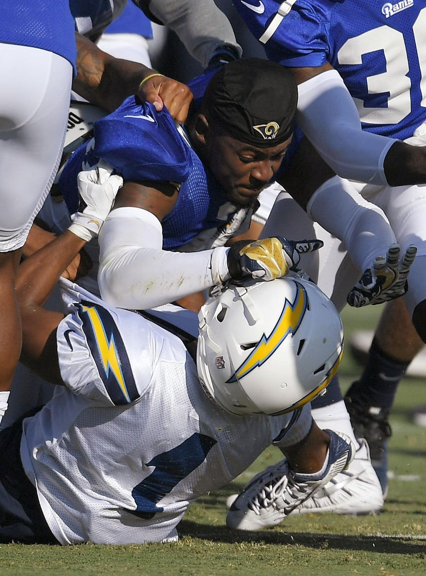 Los Angeles Rams cornerback E.J. Gaines, top, and Los Angeles Chargers wide receiver Jamaal Jones scuffle during a joint NFL football practice, Wednesday, Aug. 9, 2017, in Irvine, Calif. (AP Photo/Mark J. Terrill)
