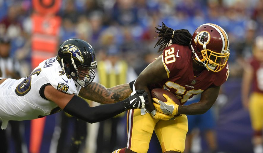 Washington Redskins running back Rob Kelley, right, tries to outrun Baltimore Ravens defensive end Brent Urban in the first half of a preseason NFL football game, Thursday, Aug. 10, 2017, in Baltimore. (AP Photo/Nick Wass) **FILE**
