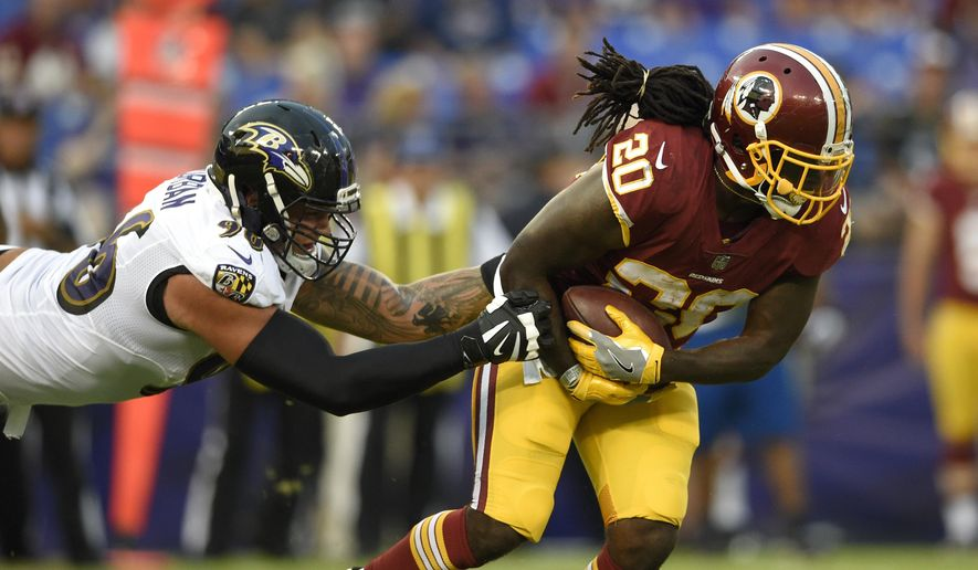 Washington Redskins running back Rob Kelley, right, tries to outrun Baltimore Ravens defensive end Brent Urban in the first half of a preseason NFL football game, Thursday, Aug. 10, 2017, in Baltimore. (AP Photo/Nick Wass)