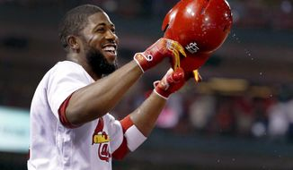 St. Louis Cardinals' Dexter Fowler takes a curtain call after hitting a grand slam during the seventh inning of a baseball game against the Kansas City Royals Thursday, Aug. 10, 2017, in St. Louis. (AP Photo/Jeff Roberson)