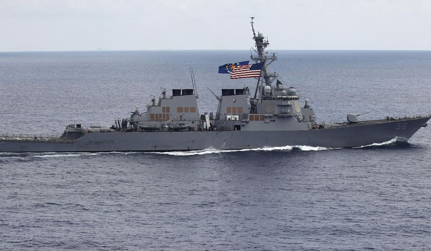 In this photo taken Saturday, Aug. 13, 2011, the USS John S. McCain (DDG-56) destroyer sails off the coast of Vietnam. A Navy official says the USS John S. McCain has sailed close to a Chinese man-made island in a freedom of navigation operation in the disputed South China Sea. (AP Photo/Na Son Nguyen, File)