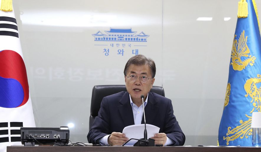 In this July 4, 2017, file photo, South Korean President Moon Jae-in speaks as he presides over a meeting of the National Security Council at the presidential Blue House in Seoul, South Korea. Moon believes the best way to solve the North Korean nuclear crisis is engagement of the sort that two past liberal leaders used to win historic summits with Pyongyang. (Kim Ju-hyung/Yonhap via AP, File)